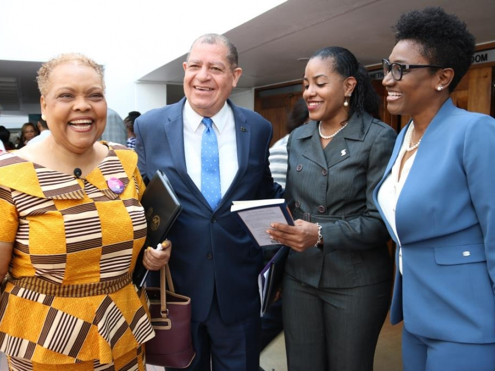 Hon. Audley Shaw (2nd left), Minister of Industry, Commerce, Agriculture and Fisheries, shares a light moment with (from left) Valerie Veira, Chief Executive Officer, Jamaica Business Development Corporation (JBDC); Avril Leonce, Director of SME Partnership and Development, and Audrey Tugwell, Executive Vice-President, Retail Banking, both of Scotiabank; at the opening ceremony of day one of the Employee Engagement Conference hosted by JBDC under the theme 'Disturb. Reconnect. Engage' at the Jamaica Confere