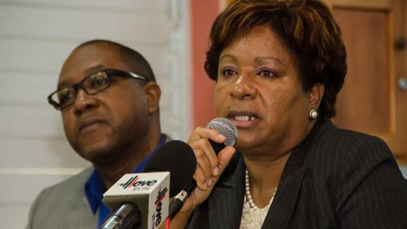 Director of the Regulatory Division at the Bureau of Standards Jamaica (BSJ), Orine Henry, addresses a press conference held at the agency's Winchester Road offices today (December 16). A left is Head of the Standards Compliance Inspectorate, Regulatory Division, BSJ, Wendell Richards.